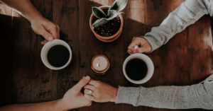 How Do You Get Your Spouse On Board With A Move? Couple making a decision over coffee